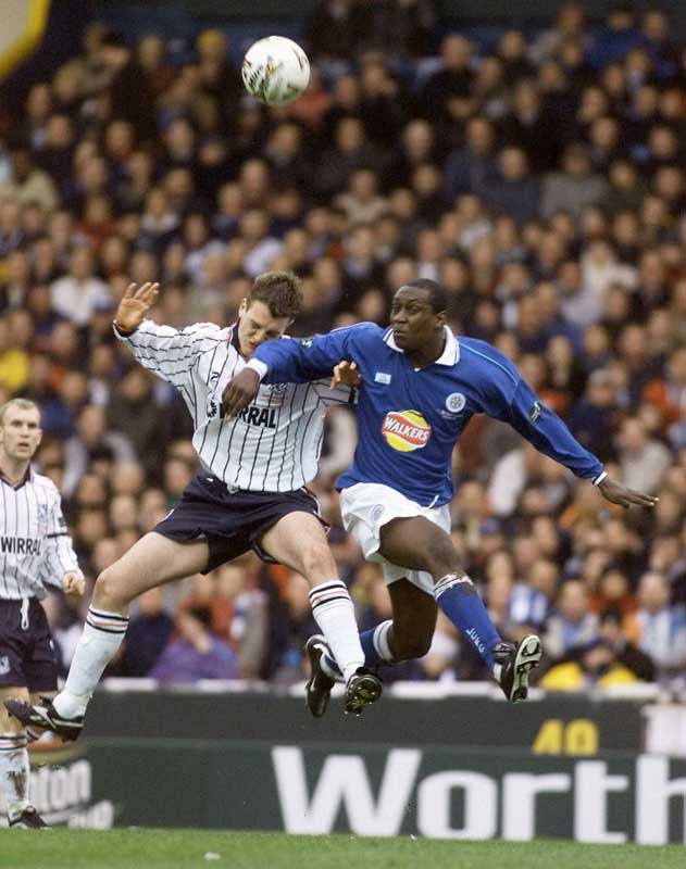 Tranmere's Clint Hill battles with Leicester striker Emile Heskey, February 2000