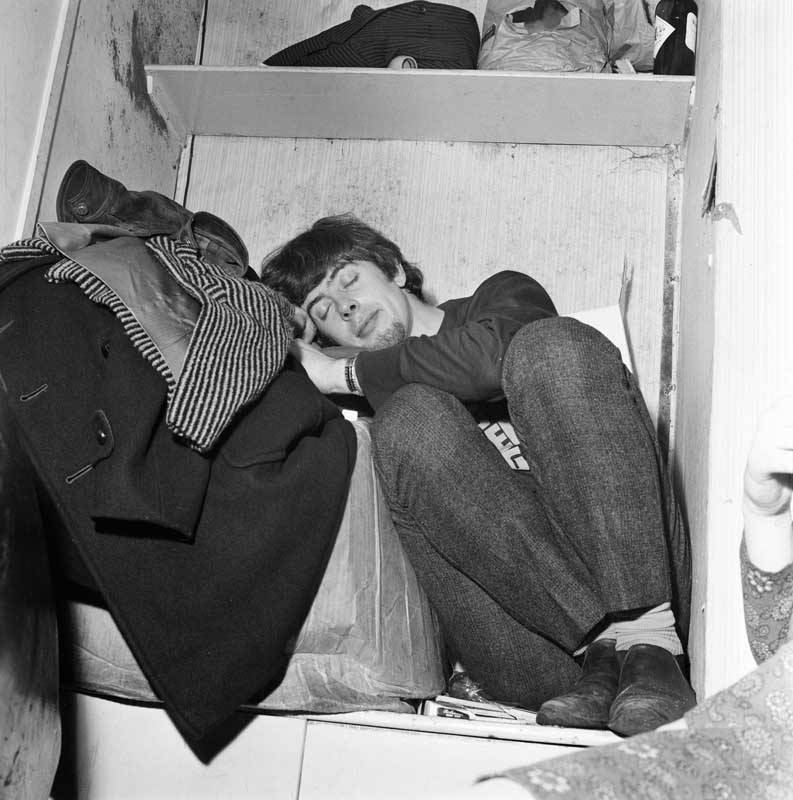 John Mayall takes a nap between performances, January 1966
