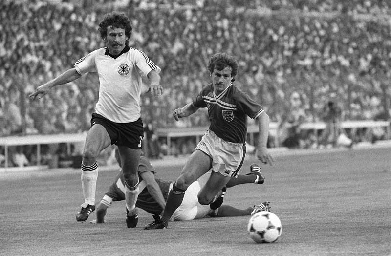 Steve Coppell battles with Paul Breitner as Germany beat England 2-0 in the 1982 World Cup