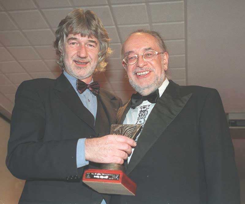 Willy Russell, left, accepts the 1998 Scouseology Award for Blood Brothers with Adrian Henri