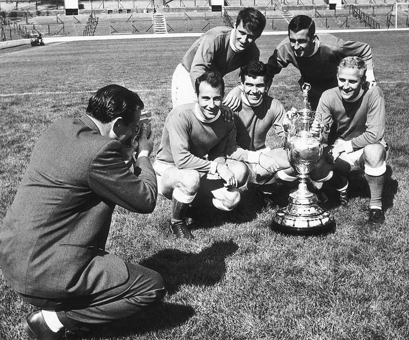 Harry Catterick films his players with the League Championship trophy, August 1963