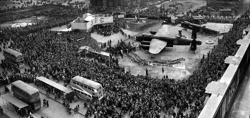 Thousands view a Lancaster bomber at the Wings for Victory wartime exhibition, March 1943