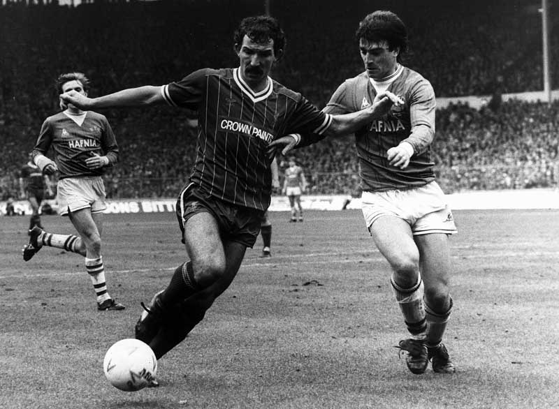 Liverpool midfielder Graeme Souness tussles with Everton's Kevin Ratcliffe, March 1984