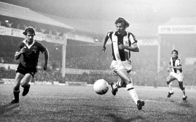 Manchester United's Jimmy Nicholl closes down West Brom's David Mills