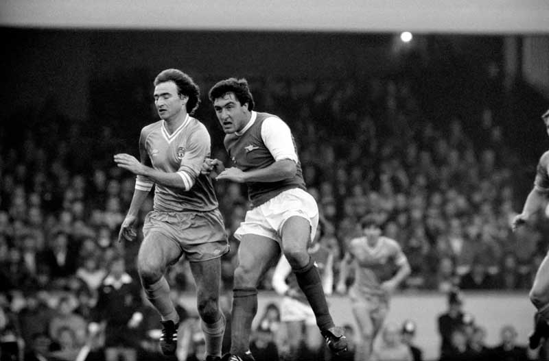 Manchester City's Martin O'Neill tries to evade Arsenal's Brian Talbot