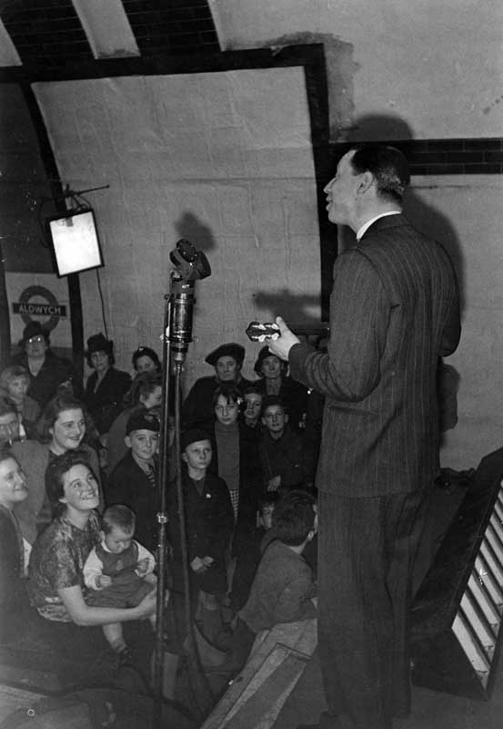 Wigan-born entertainer George Formby singing in Aldwych tube station, November 1940