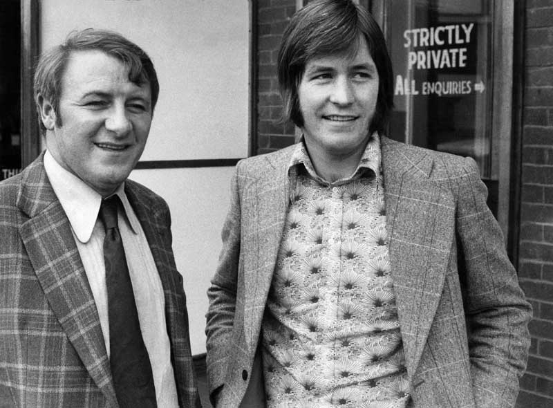 Tommy Docherty, left, with new signing, midfielder Jim McCalliog, March 1974