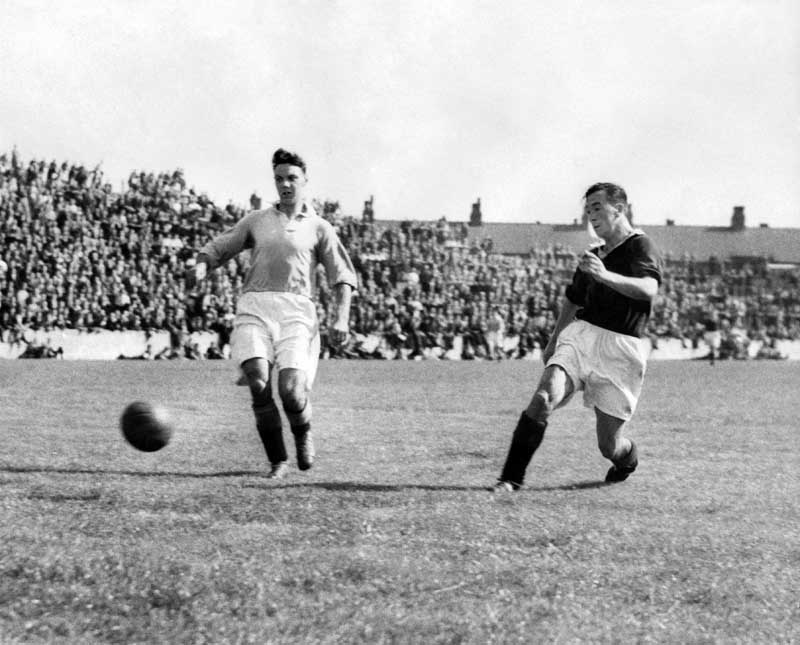 Billy Jones, right, and Joe Fagan battle it out in a City practice match, August 1949