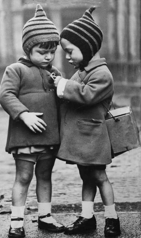 Evacuees check their labels in a picture of childish innocence, September 1940