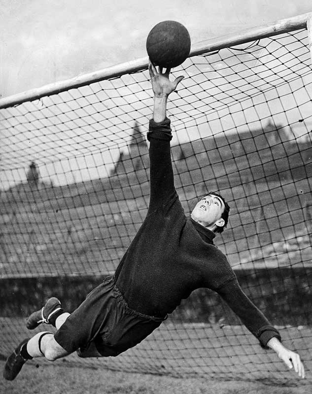 City and England goalkeeper Frank Swift tips the ball over the bar in training, January 1946