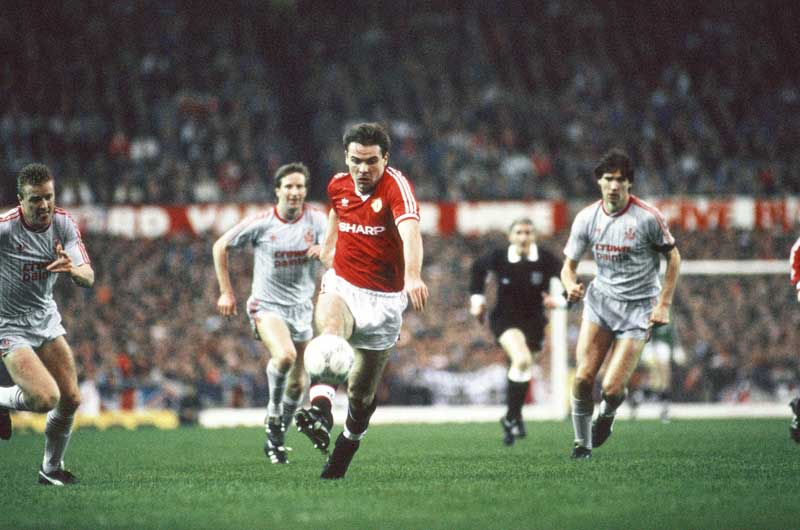 Brian McClair bursts through Liverpool defence at Old Trafford