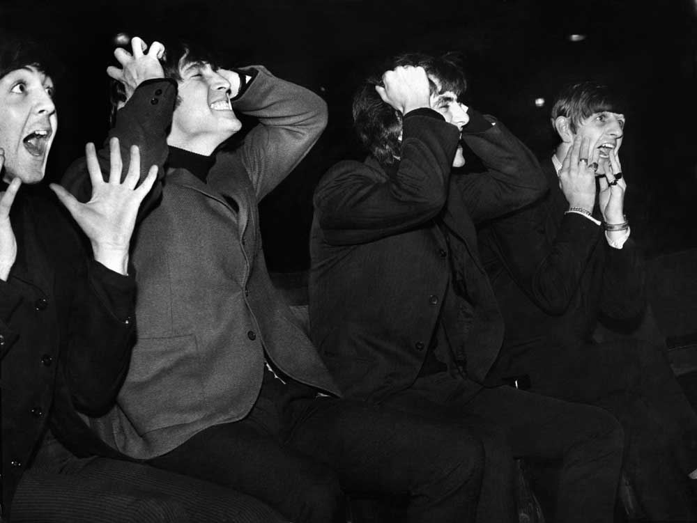 The Beatles mimic screaming fans at the Astoria Cinema, December 1963