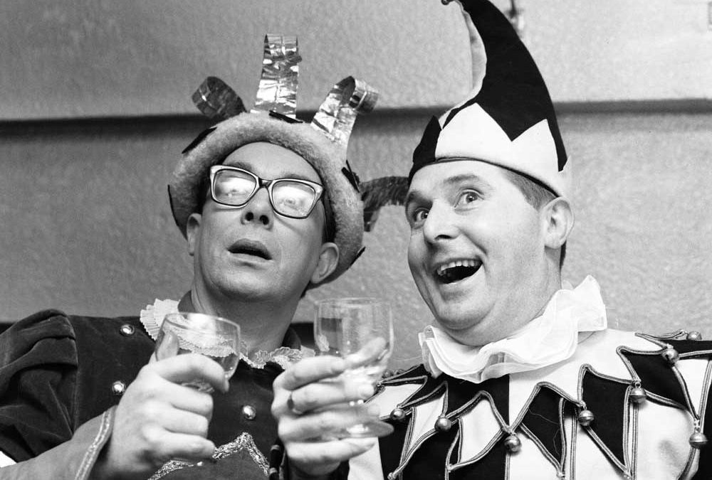 Morecambe and Wise toast their pantomime Sleeping Beauty at the Palace Theatre, February 1965
