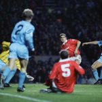 United icon Eric Cantona takes a shot during his league debut against City, December 1992