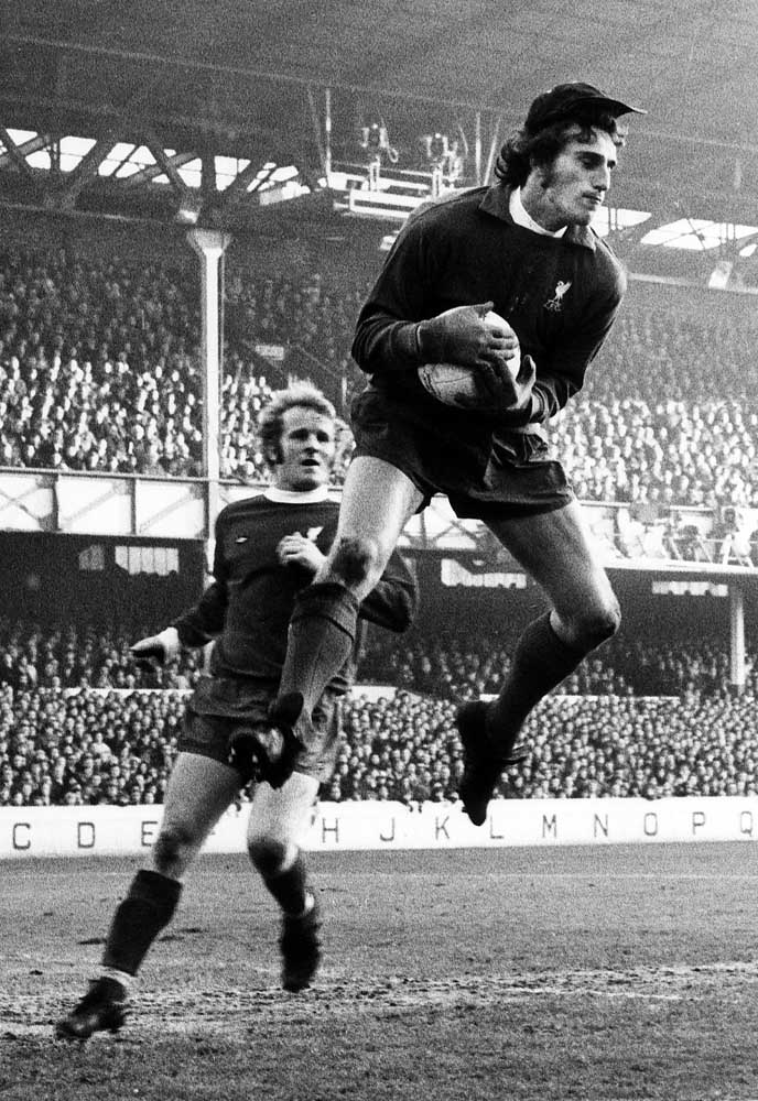 Ray Clemence safely gathers the ball against Everton with Alec Lindsay covering, December 1973