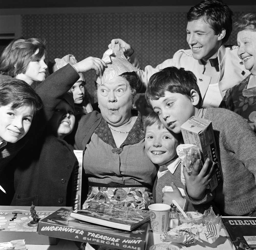Violet Carson (Ena Sharples) with children at the Coronation Street pantomime, December 1964