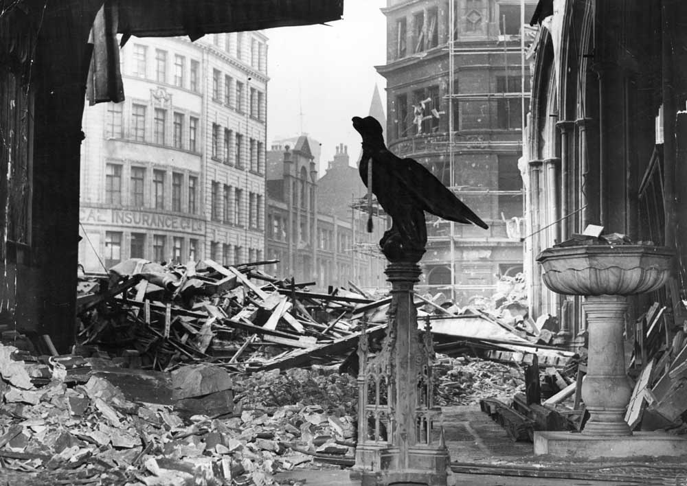 The eagle of a church lectern stands defiant in the midst of destruction, December 1940