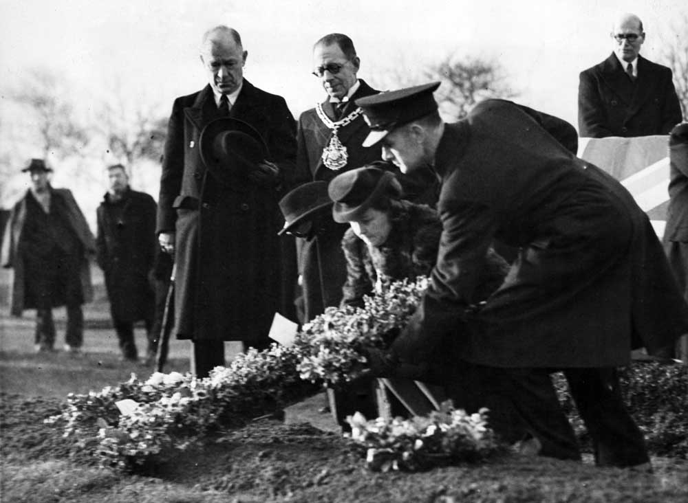 Mayoress of Salford, Mrs L Webb, lays a wreath for Christmas Blitz victims, December 1943