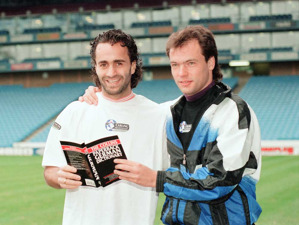 City's German signings Uwe Rosler and Maurizio Gaudino pose for the press, February 1995
