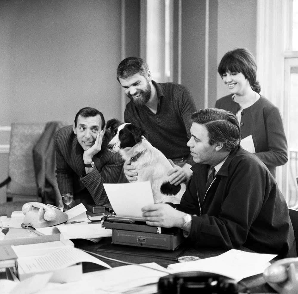 Scriptwriters Ray Galton, standing, and Alan Simpson with Eric Sykes, left, Jeanne Corbett and Pickles the dog, March 1966