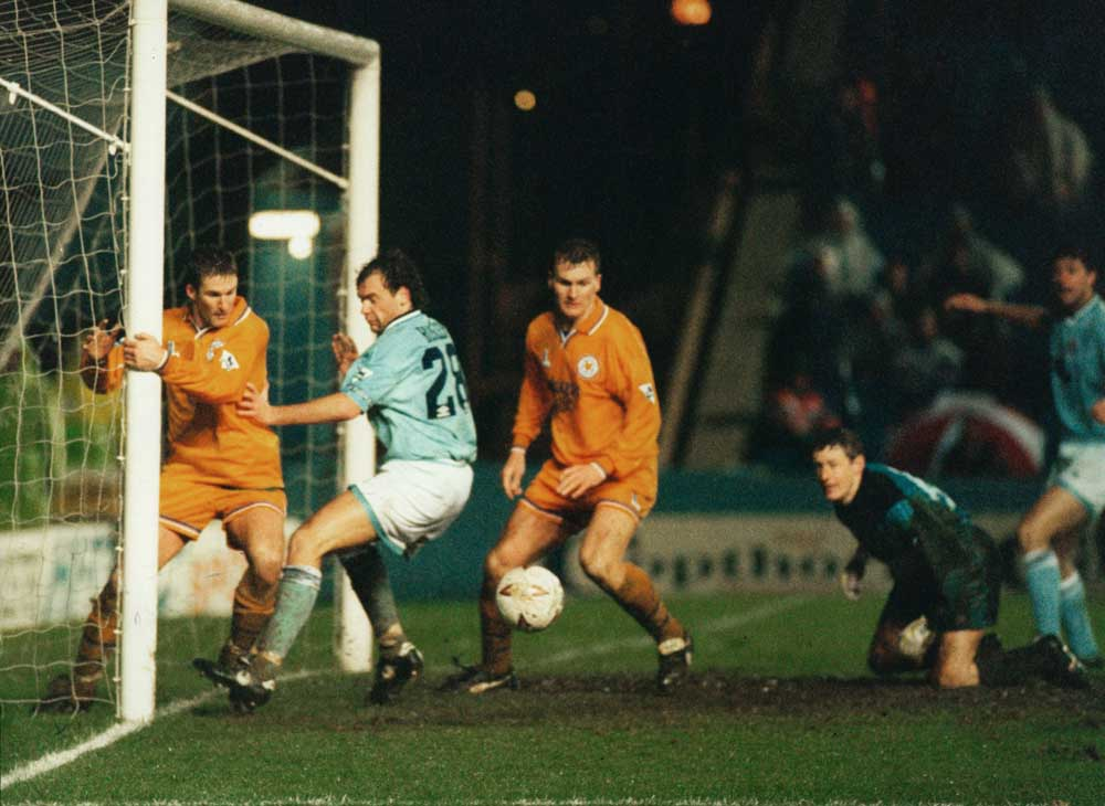 So close! Uwe Rosler's shot against Leeds is blocked on the line, January 1995
