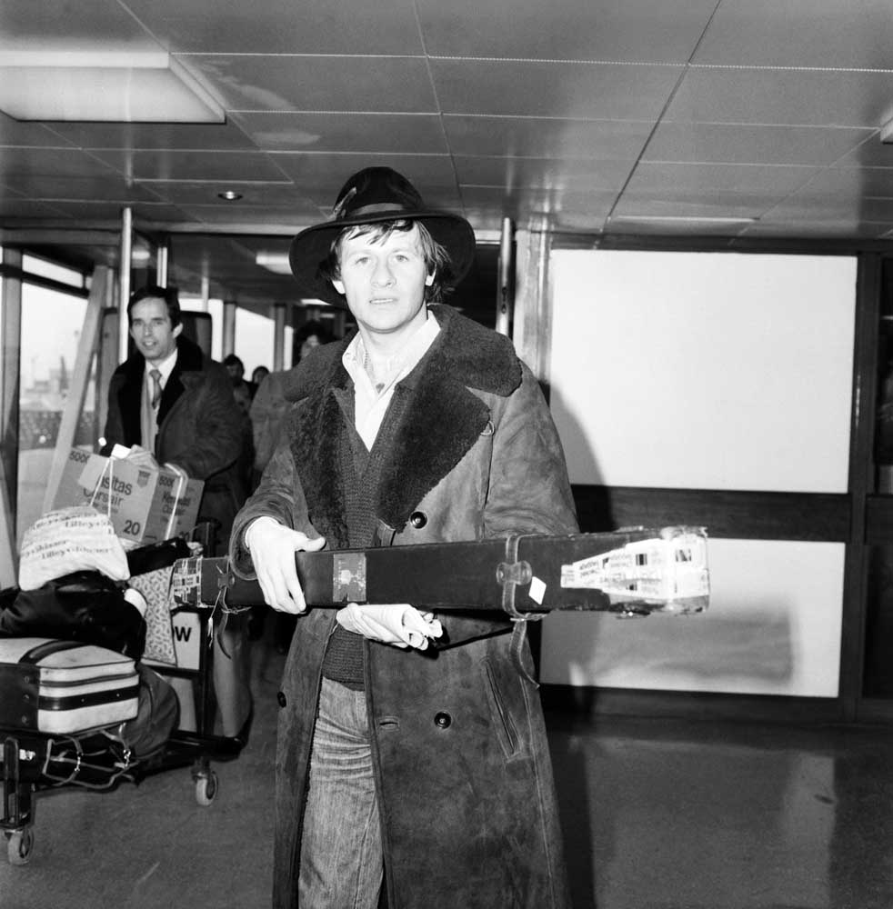 Alex 'Hurricane' Higgins and John Spencer ready to fly to Manchester, February 1981
