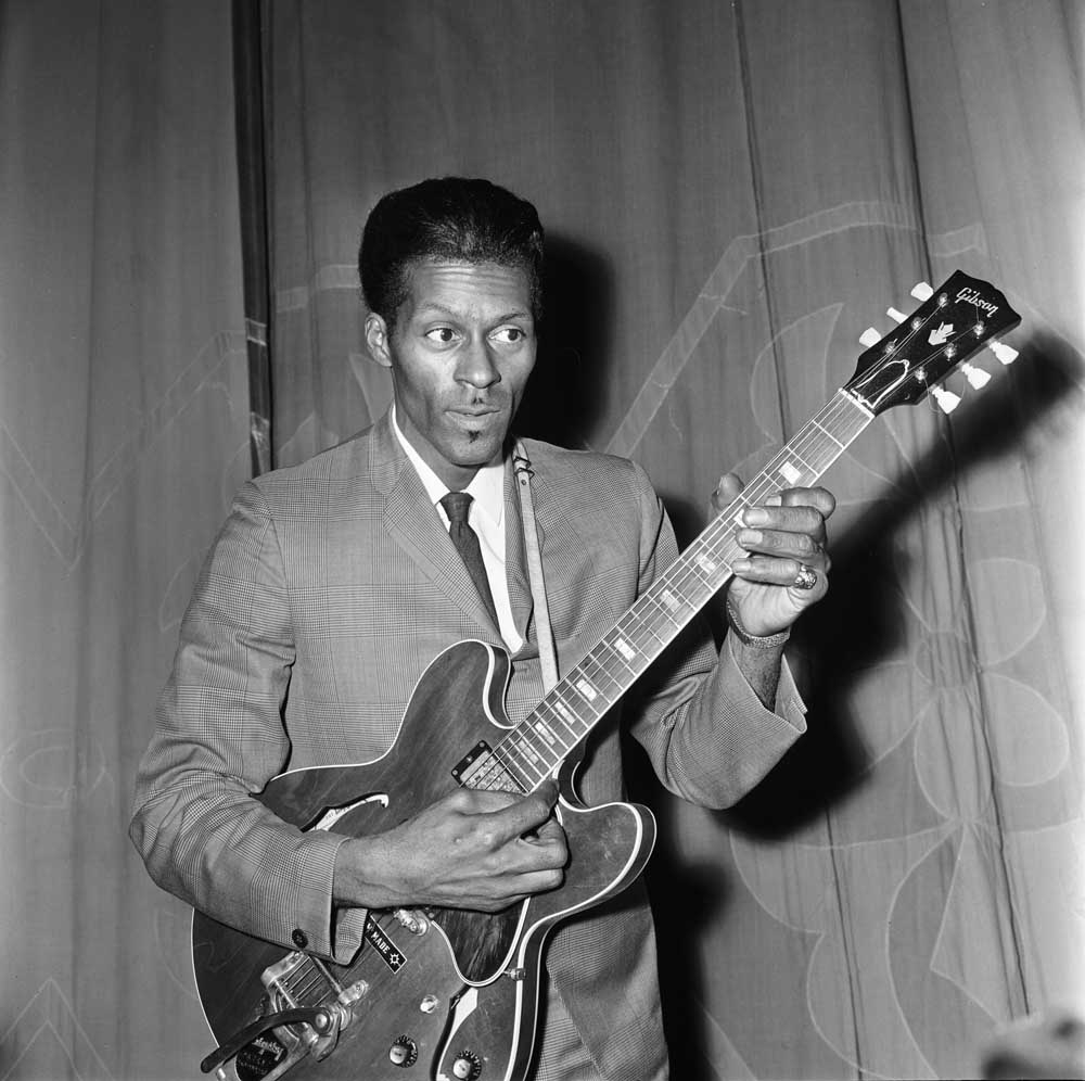 Chuck Berry tunes up for his Manchester concert, January 1965