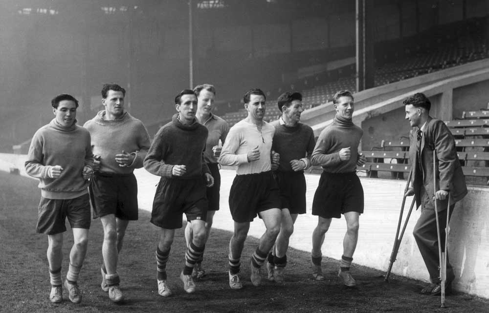 Injured FA Cup up hero Johnny Hart watches his team-mates train, April 1955