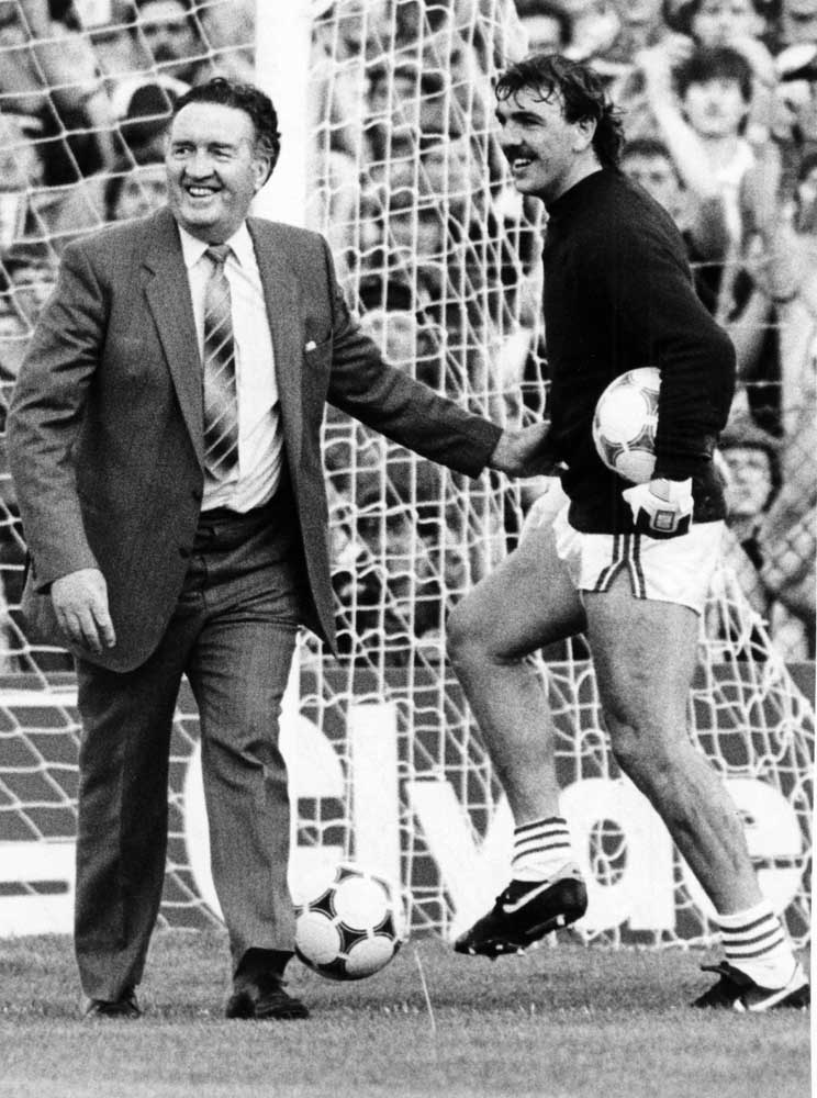 Neville Southall, playing for Wales, jokes with Scotland manager Jock Stein, September 1985