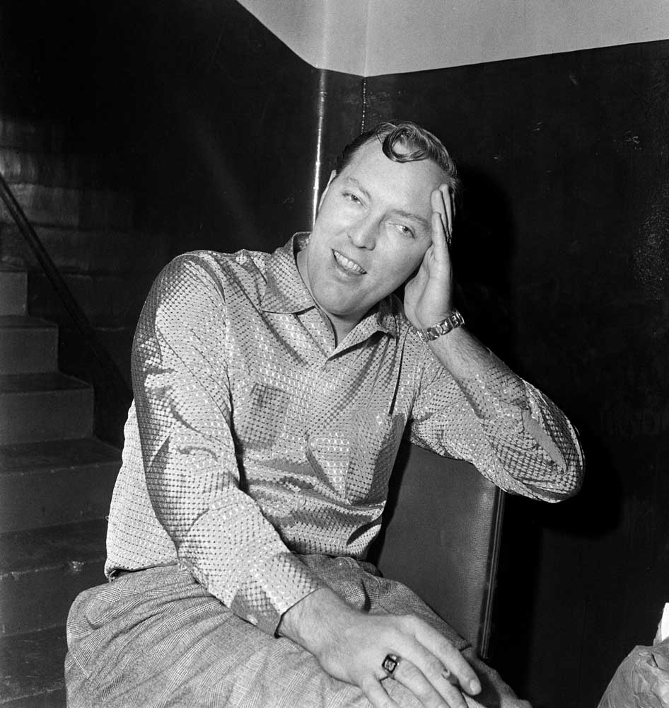 Bill Haley relaxing backstage at the Odeon, Manchester, February 1957