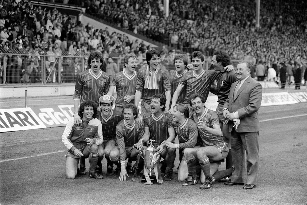 Manager Bob Paisley and his Liverpool team celebrate winning the Milk Cup at Wembley, March 1983