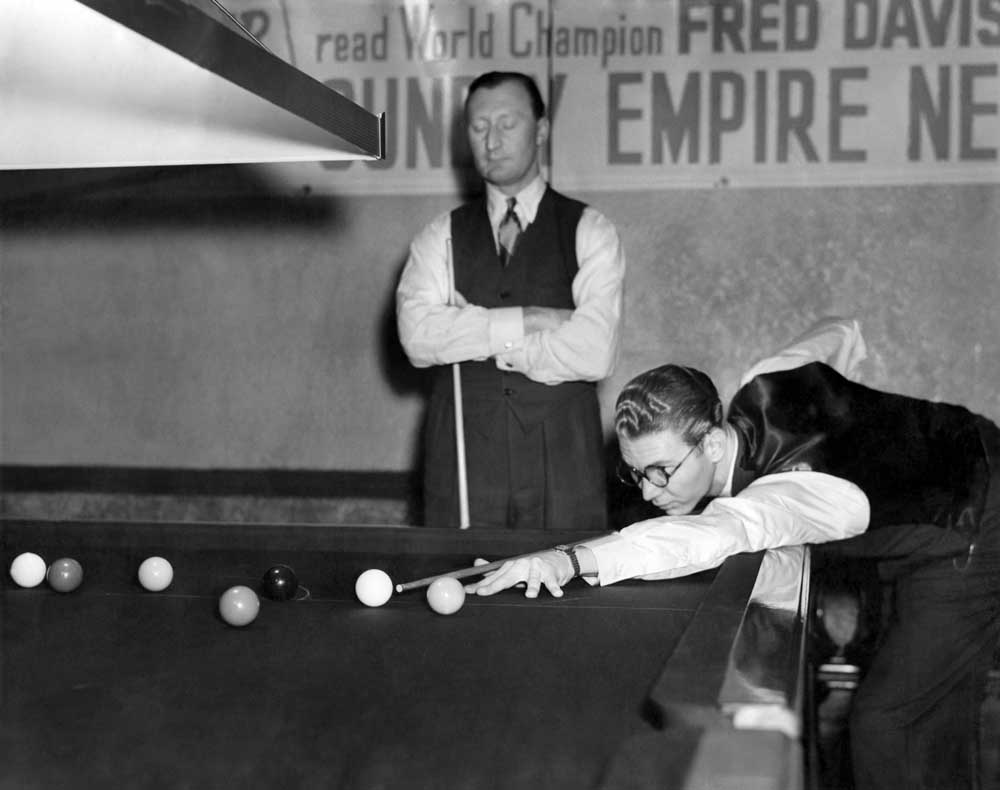A young John Pulman lines up a shot at the World Snooker Championships, December 1949