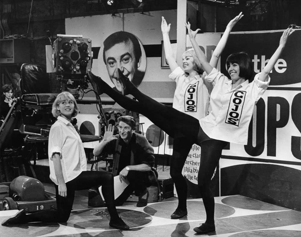 Top of the Pops producer Johnnie Stewart with the Gojos dance trio, December 1964