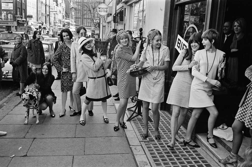 Cilla Black, right, with Cathy McGowan at London's Biba boutique, February 1966