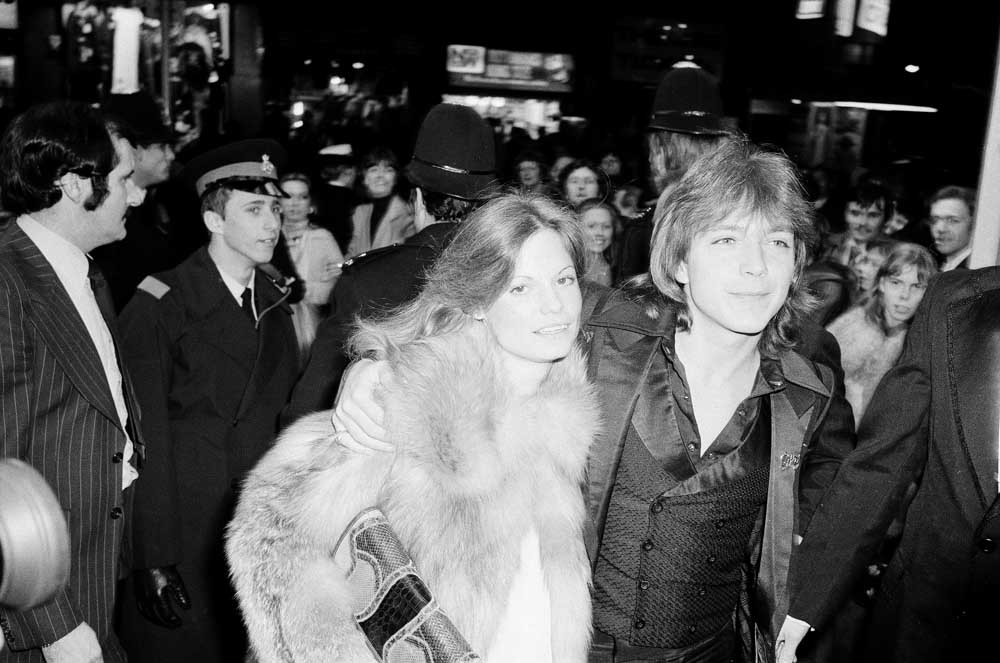 David Cassidy arrives in the UK with his secret fiancée, February 1990