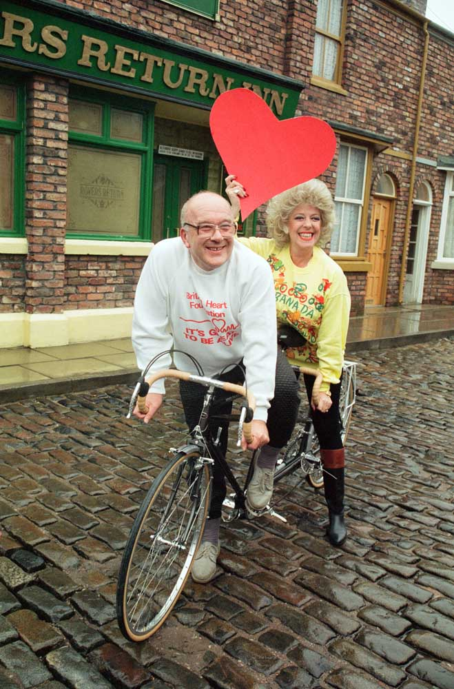 Julie Goodyear and Roy Barraclough with a big Valentine's Day love heart, February 1990