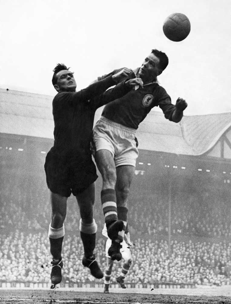 Sheffield United 'keeper Alan Hodgkinson challenges Liverpool's Billy Liddell, April 1958