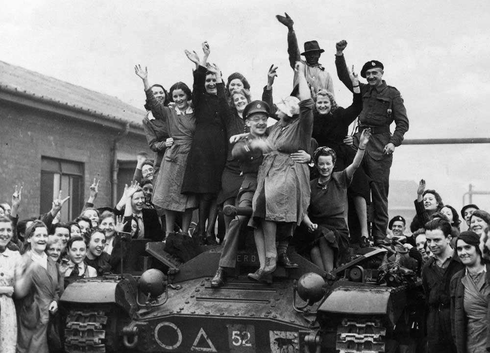 Workers at a Kirby munitions factory welcome a visiting tank crew, November 1941