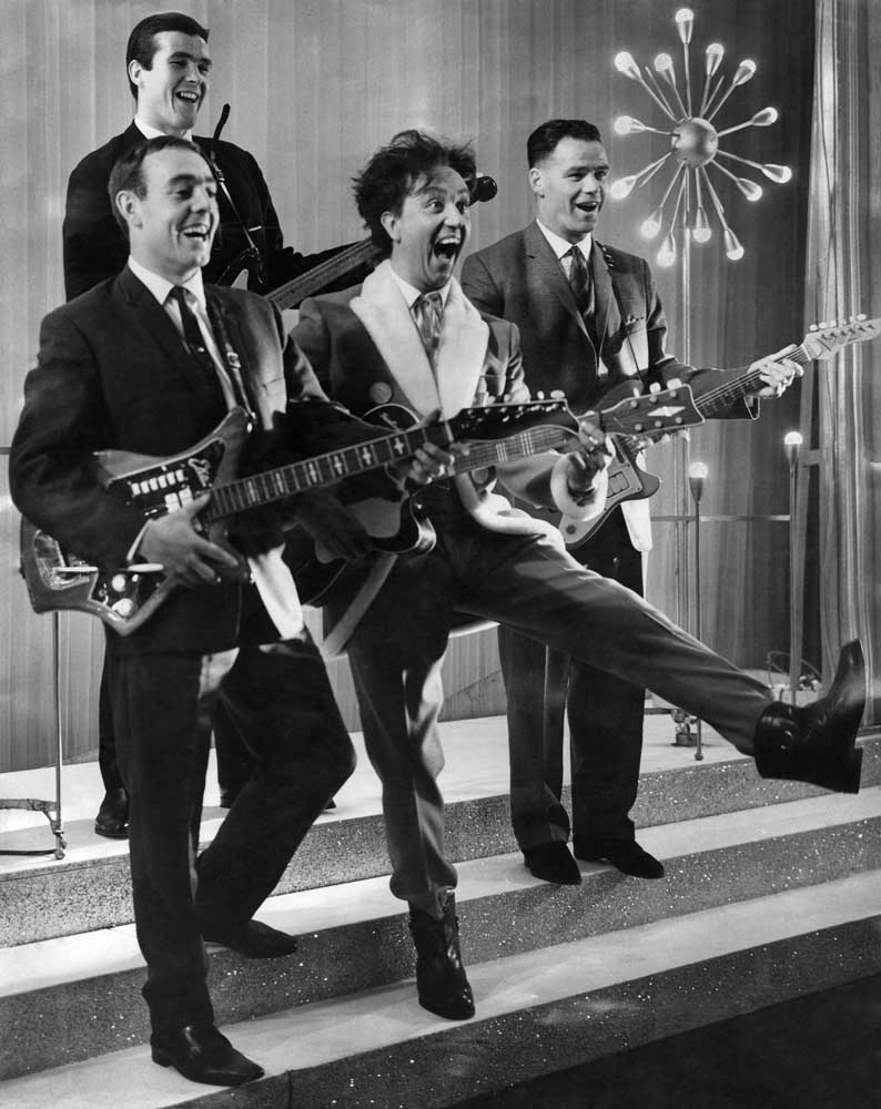 Ken Dodd with Ian St John, Ron Yeats and Billy Liddell posing as the Beatles, December 1963
