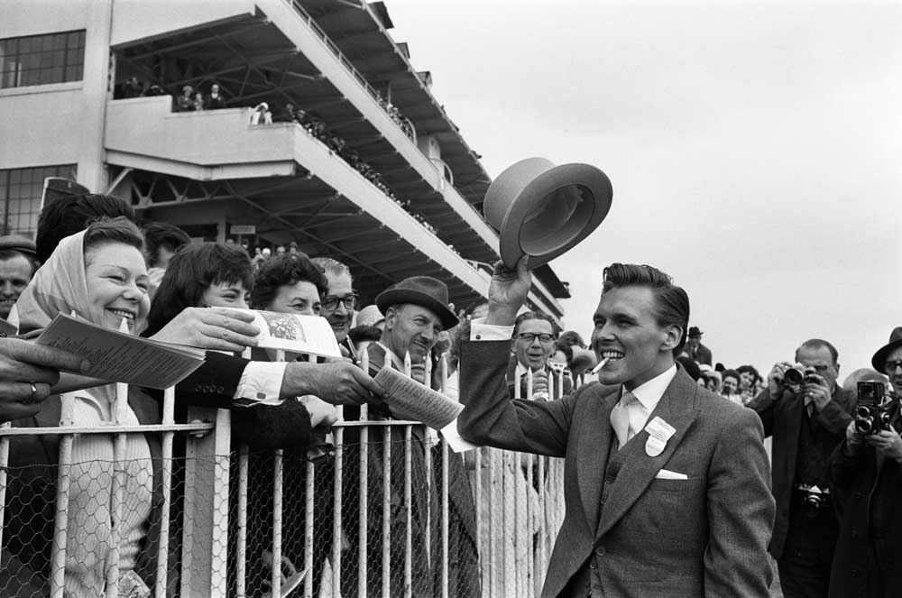 Crowds cheer racehorse owner Billy Fury at the Epsom Derby, June 1964