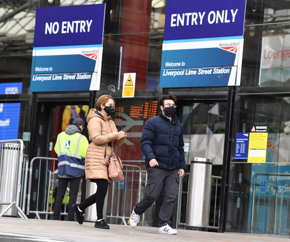People coming out of Lime Street Station on the first day of the new lockdown regulations.(Pic Andrew Teebay).