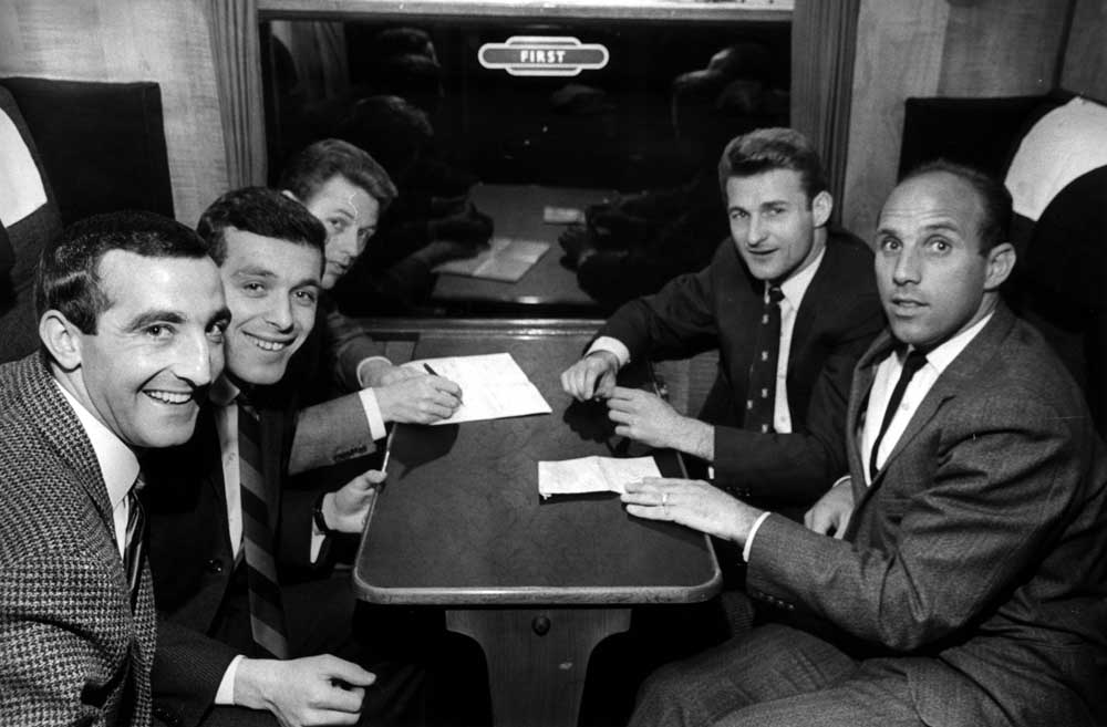Liverpool football players sitting in first class