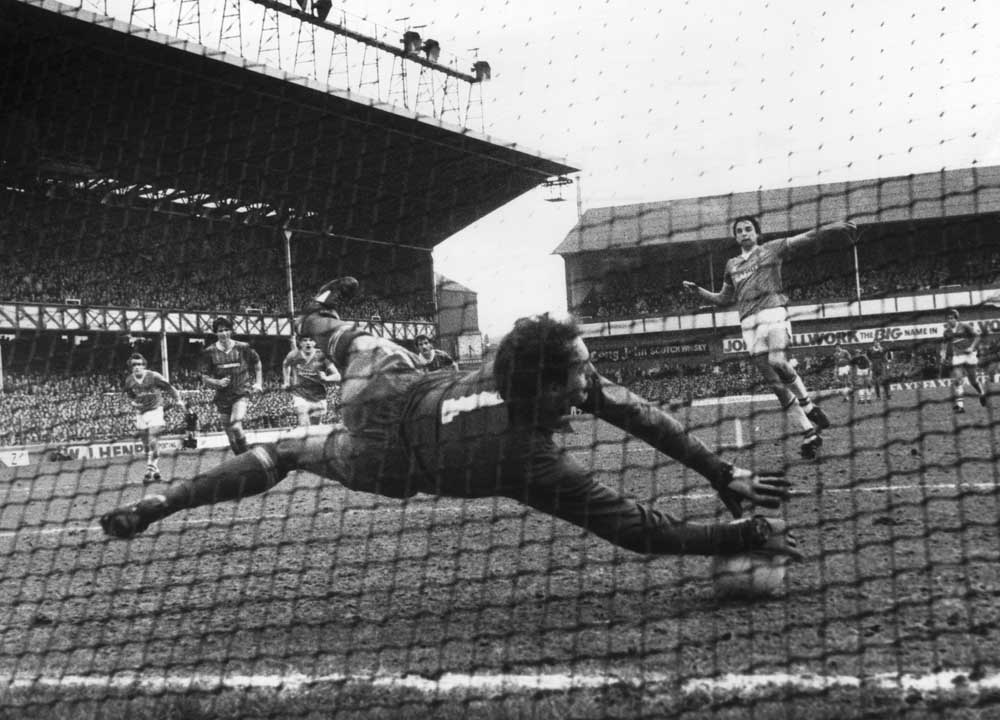 Bruce Grobbelaar saves a penalty from Everton's Graeme Sharp in a 1-1 league draw, March 1984