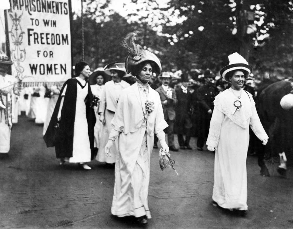 Emmeline Pankhurst, centre, in a procession with daughter Christabel dressed in black and white, January 1910