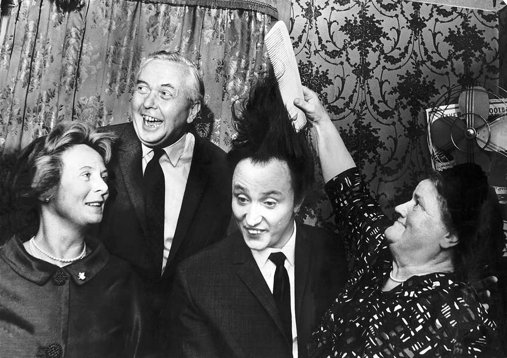 Bessie Braddock tries to comb Ken Dodd's unruly locks at the London Palladium with Prime Minister Harold Wilson and his wife Mary, September 1965