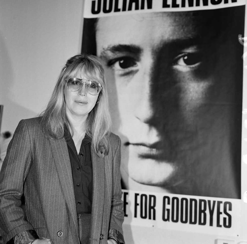 Cynthia Lennon with a poster of her son Julian, November 1984