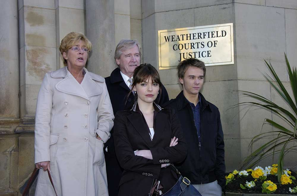 Deidre Barlow (Anne Kirkbride) and daughter Tracy (Kate Ford) outside court with Ken Barlow (William Roche) and David Platt (Jack P. Shepherd), February 2007