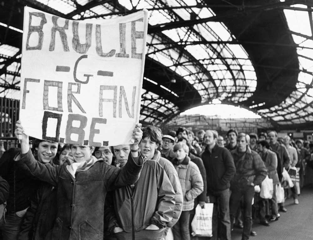Fans carry a Grobbelaar banner at Lime Street station ahead of the League Cup final, March 1982