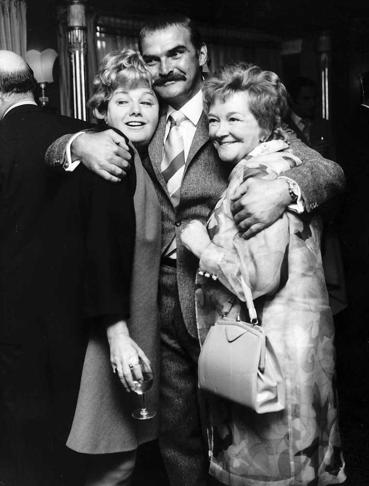 Shelley Winters, left, and Stanley Baker at a party with Beryl Reid, July 1969