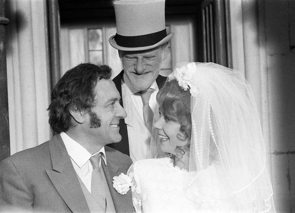 Carolyn Seymour plays Harold Steptoe's bride Zita with Harry H. Corbett and Wilfrid Brambell in the film Steptoe and Son, October 1971